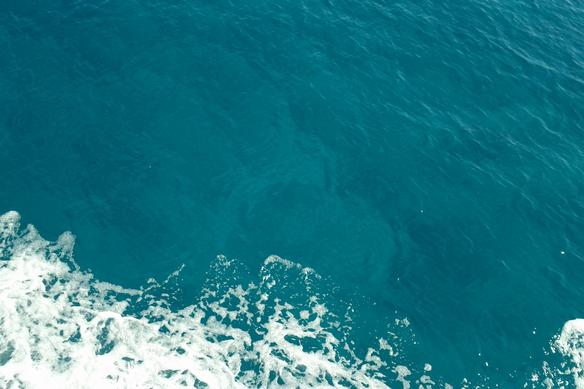 Sea foam against a boat