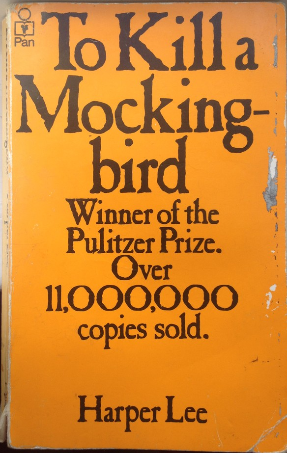 Orange cover of paperback edition of To Kill A Mockingbird